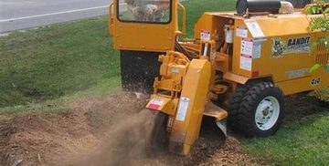 Picture of our stump grinder machinery grinding up a stump in Carmel, IN